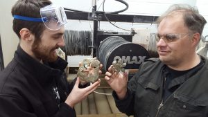 Kelie (left) and Jeremy (right) show off a stone gear