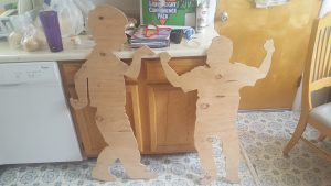 Plywood silhouettes of Winchester and John Fenley