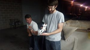 Kelie (right) shows off his Batman grappling hook